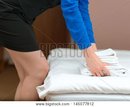Room Service. Woman Changing Towels In Hotel Room.