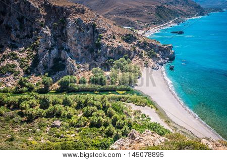 Preveli Beach in Crete island, Greece. There is a palm forest and a river inside the gorge near this beach.