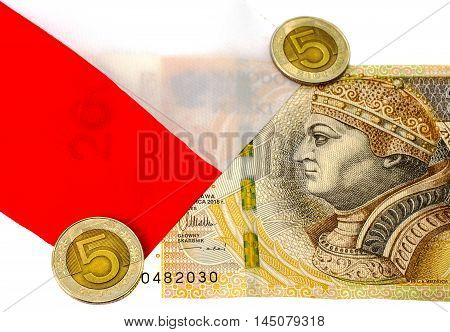 Denomination 200 zlotys and coins 5 zloty against the backdrop of the Polish flag.
