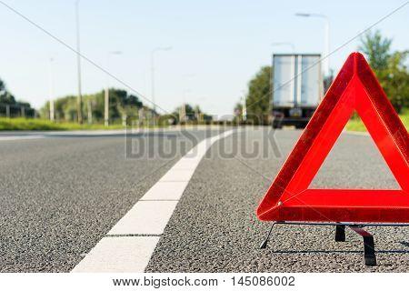 Cargo truck with a breakdown alongside a road