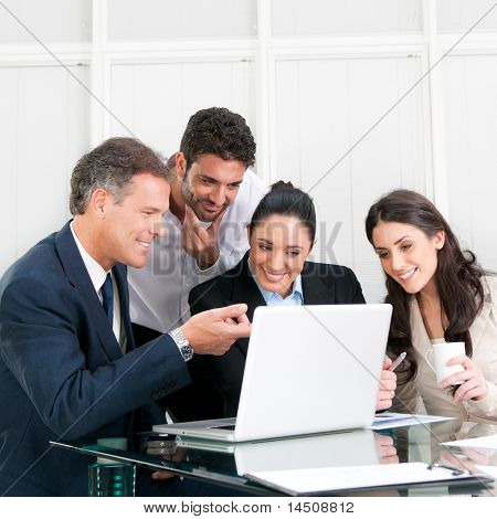 Happy working business team in modern office