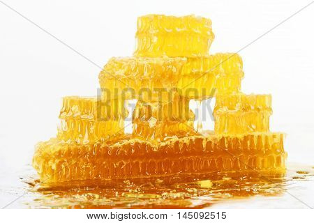 the pyramid of honeycomb on white background