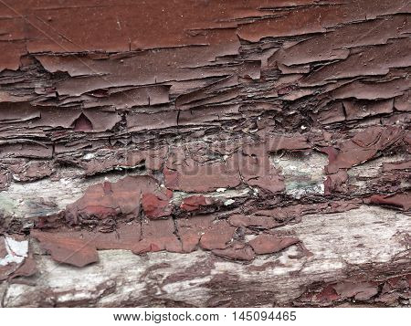 Brown chipping paint on old wood surface