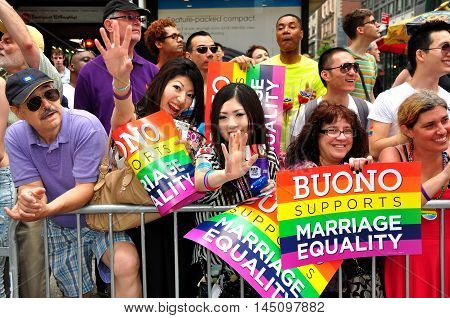 New York City - June 29 2013: Spectators holding Barbara Buono Marriage Equality signs at the 2013 Gay Pride Parade on Fifth Avenue