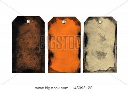 Three unique handmade Halloween or autumn themed gift tags isolated on white