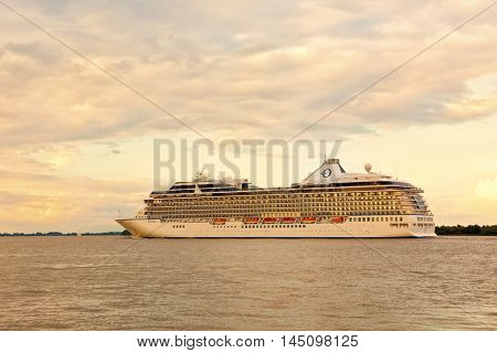 Stade, Germany - August 21, 2016: Cruise ship MS Marina, operated by Oceania Cruises, on the Elbe river near Hamburg.