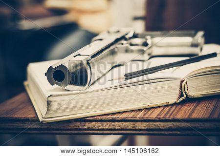 A gun on a textbook / gun allowed in some US university concept