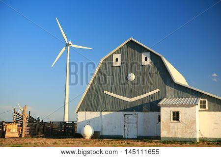 Smiling face with a wind turbine in the background