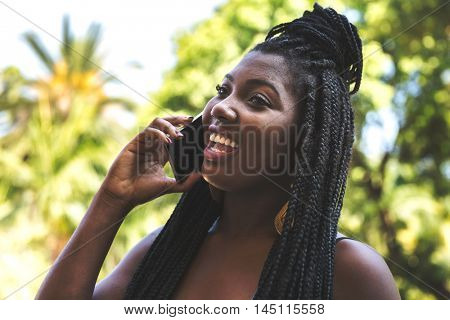 Afro young girl talking on the phone