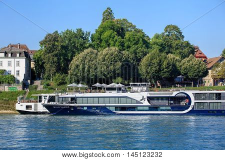 Basel, Switzerland - 27 August, 2016: ships at a pier on the Rhine river. Basel is a city on the Rhine river in northwestern Switzerland, situated where the Swiss German and French borders meet.
