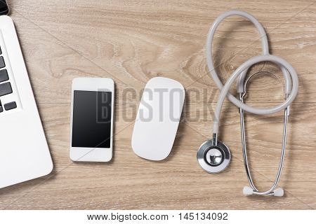 Stethoscope in doctors desk. View from above