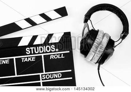 Slate film and headphone  equipment, film, white backgroun