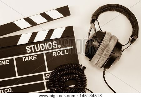 Slate film and headphone directorate, effect white backgroun