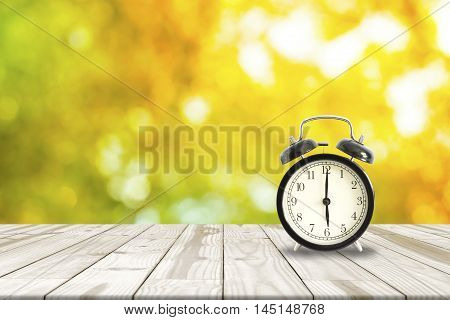 Alarm Clock On Wood Table And Shinny Bokeh In Background