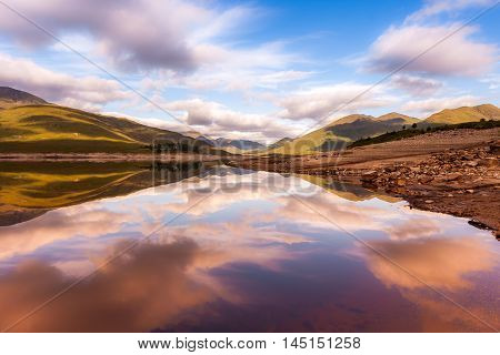 Beautiful sunrise on a Scottish Lake with reflections