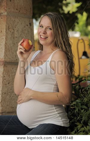 Expecting Mother Eating Apple