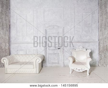 Vintage Interior with Sofa Armchair Stucco Wall and Door Gray Background