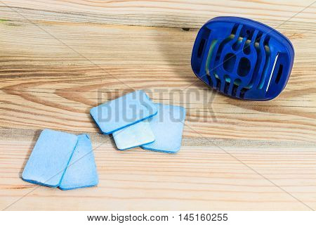 Blue Anti-mosquito electrical fumigator on wooden background