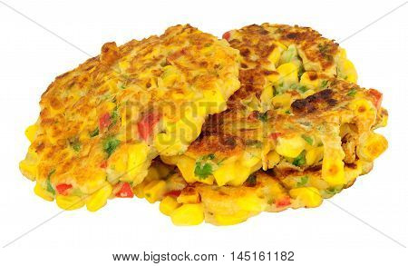 Fried sweetcorn and chilli pepper fritters isolated on a white background