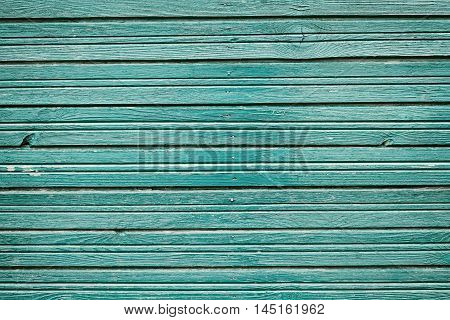 Old vintage wooden planks with blue color paint, rustic wall for background, carpentry, large scale.