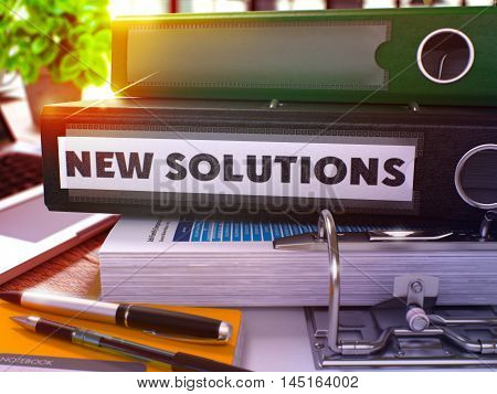 New Solutions - Black Ring Binder on Office Desktop with Office Supplies and Modern Laptop. New Solutions Business Concept on Blurred Background. New Solutions - Toned Illustration. 3D Render.