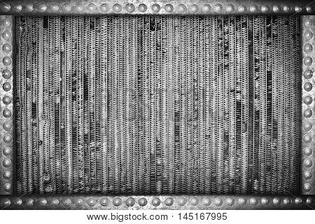 damaged radiator background with metal rivets frame