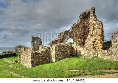 Hastings Castle sits high on the cliffs, overlooking the town and the English Channel beyond. Today only ruins remain.