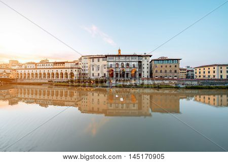 Cityscape view on Arno riverside with Canottiery arch building and Famous Uffizi museum on the sunset in Florence
