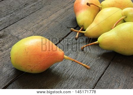 Fresh pears on wooden background. Close up view of ripe pears. View with fresh pears.