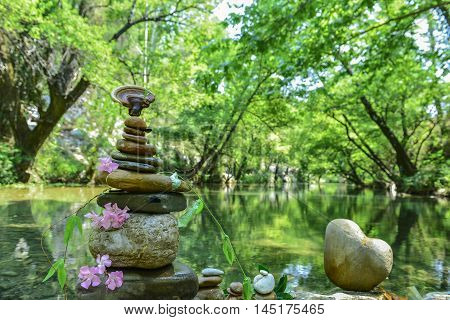 the concept of peace and zen stones in the river