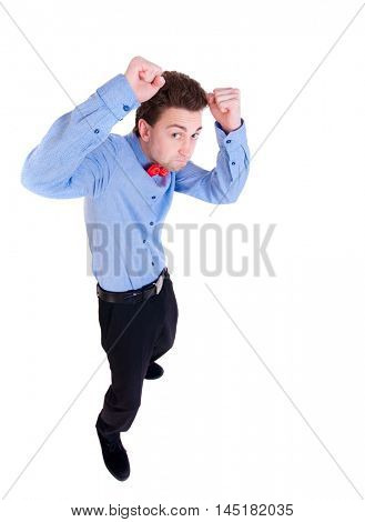 businessman in a tie butterfly in a fighting stance. backside view of person. the little man fighting with their fists.