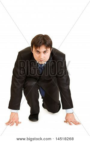 Confident modern businessmen in start position ready for race isolated on white