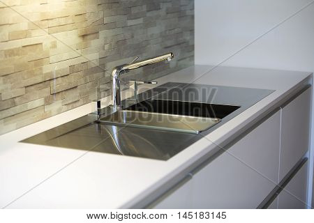 close up of modern stylish stainless steel kitchen sink