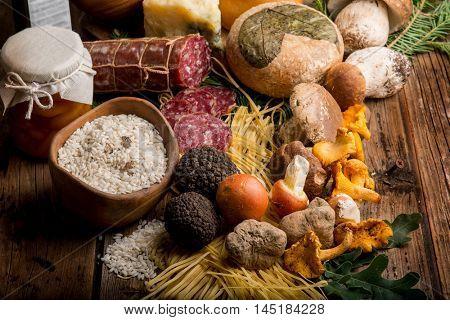 mixed italian luxury food with truffle cep mushroom ovum cheese salami