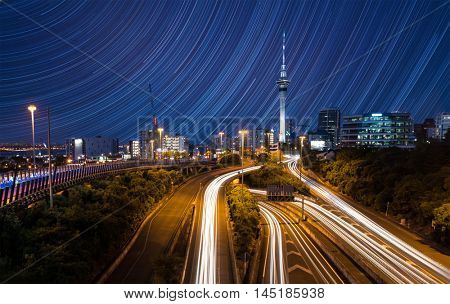 Auckland City Lights  Auckland's Night Traffic after dusk and star trails on blue night sky