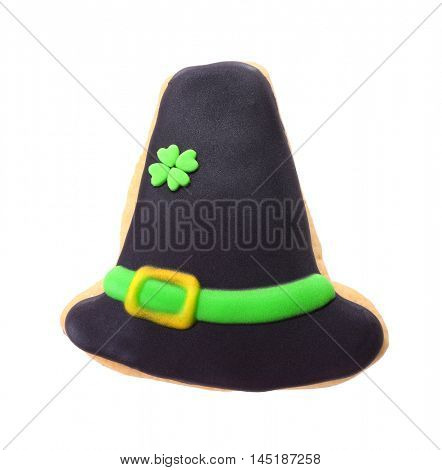 Tasty cookie in hat shape, isolated on white. Saint Patrics Day concept