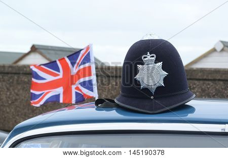 The custodian helmet with the Humberside Police badge and national flag of the United Kingdom.