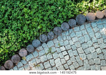 Short Grass Lawn And Cobblestone Pavement Texture
