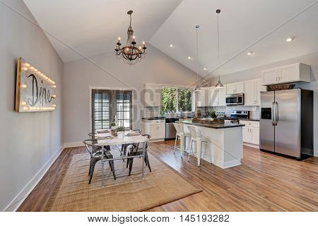 Interior Of Kitchen And Dining Room With High Vaulted Ceiling.