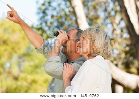 Couple looking at the sky with their binoculars