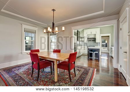 American Dining Room Interior With Table And Red Chairs