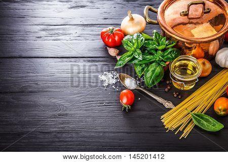 Italian food preparation pasta on wooden board in style copyspace
