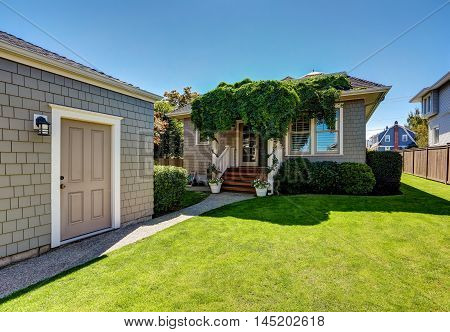 Nice Green Shed In The Backyard. American Craftsman House.