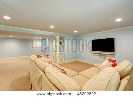 Spacious Basement Living Room Interior In Pastel Blue Tones