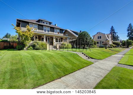 Nice curb appeal of American craftsman style house. Column porch view and freshly mowed garden lawn. Northwest USA poster