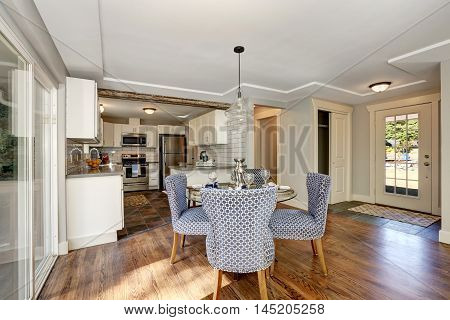 Dining Area With Blue Chairs And Table Setting