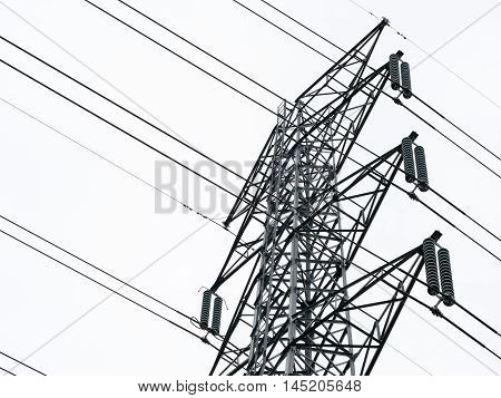 Electricity post. Closeup of electric pole tower isolated on white background.