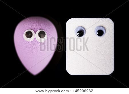 Make up - sponges with googly eyes. isolated on black background.