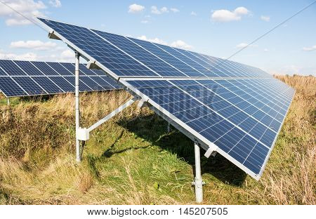 Renewable energy. Close view on the long solar panel