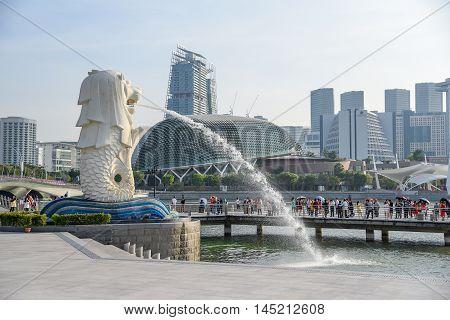 SINGAPORE - MAY 6 2016 : Tourists visit the Merlion Park a famous symbol of Singapore.